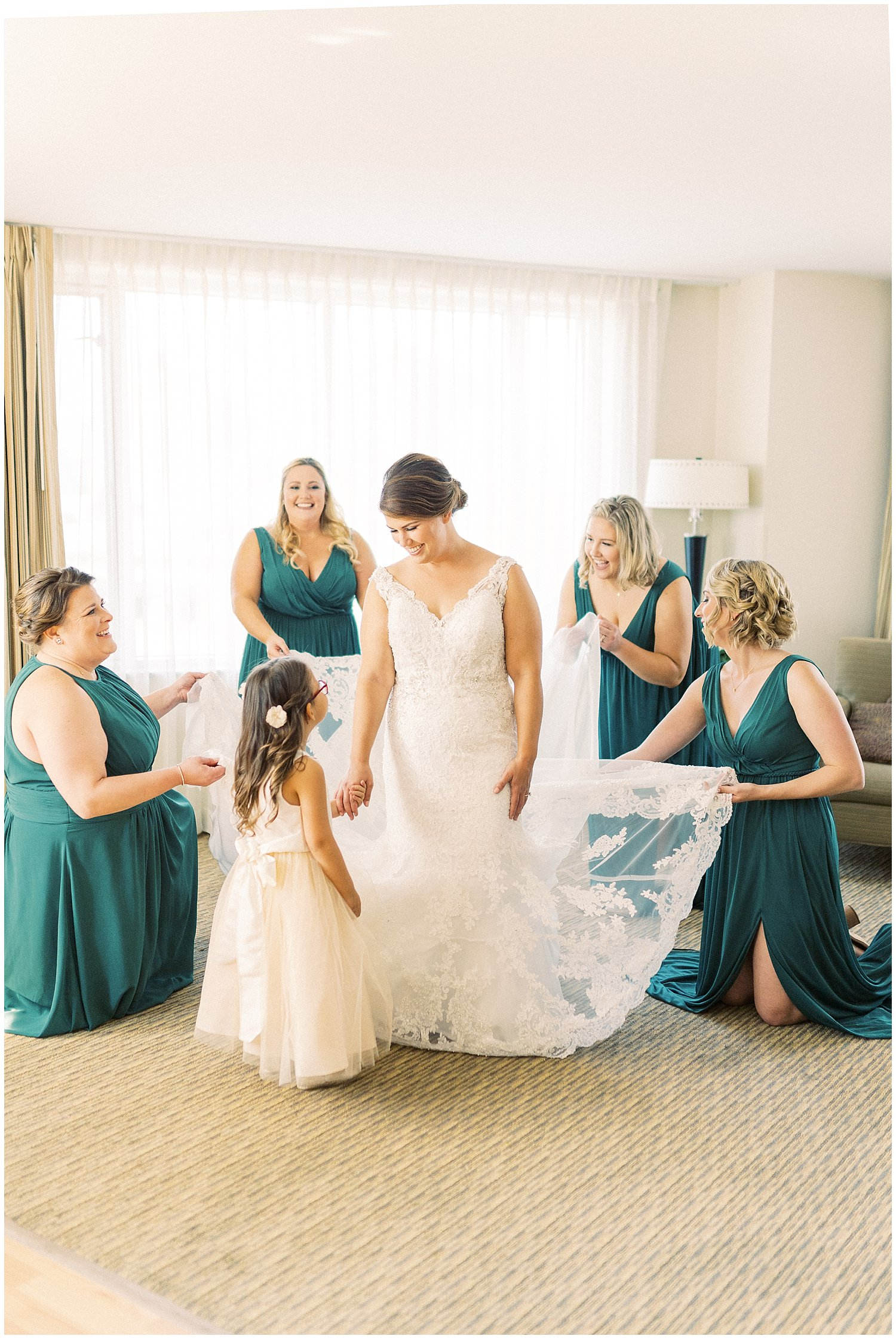 Bride with hunter green bridesmaid dresses from Azazie