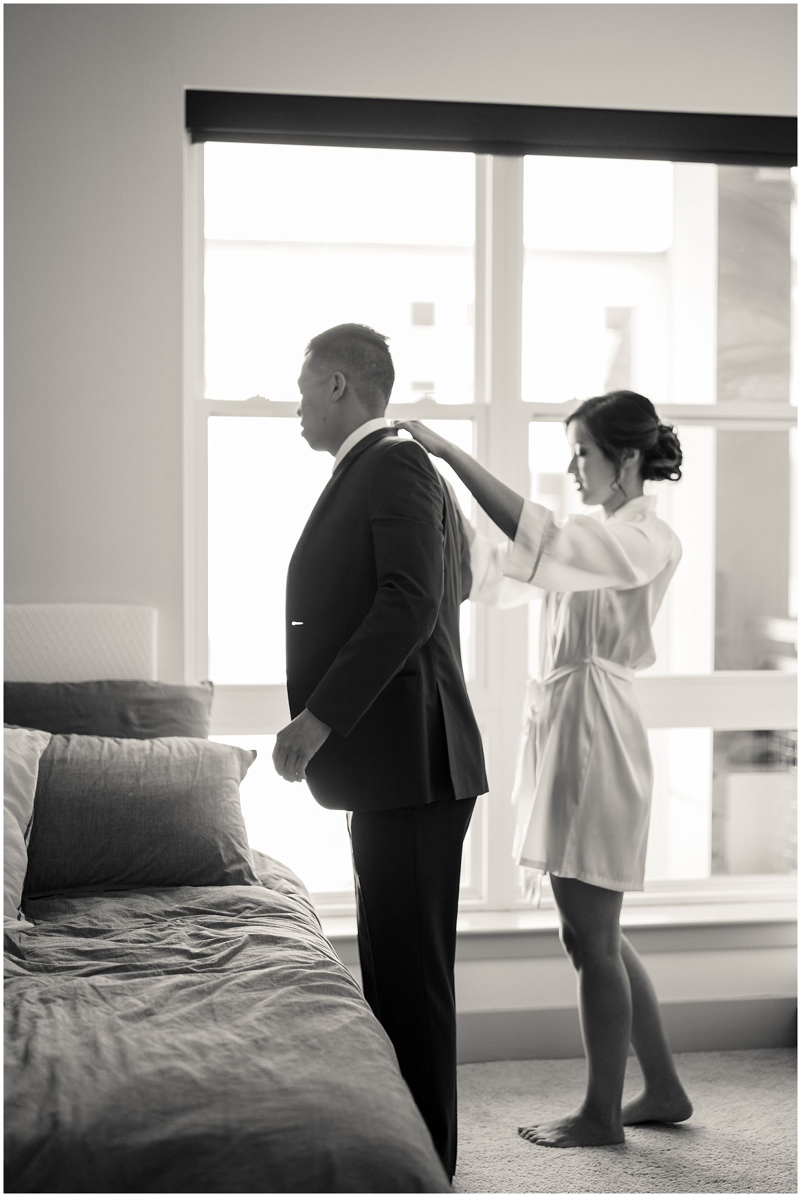 Bride and groom getting ready together on wedding day